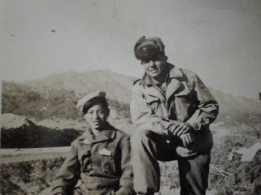 With his friend during the Korean War.